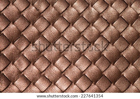 Woven leather background in bronze color - stock photo