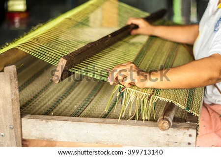 Woven mats handmade from dry reed imbue make in thailand - stock photo