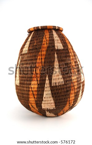 Woven open basket from Botswana made from the fiber of the Mokola palm tree. - stock photo