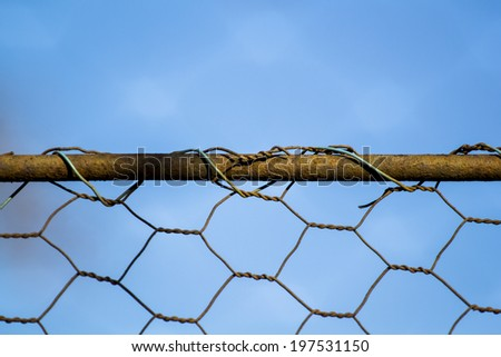 Woven rusty wire fence - texture - stock photo