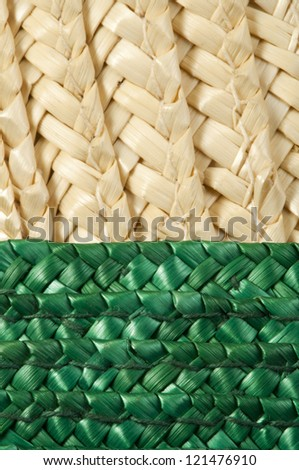 Woven straw natural background. Green and beige colors