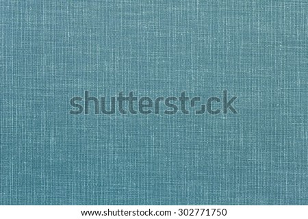 Woven tweed cloth fragment with tones of blue. - stock photo