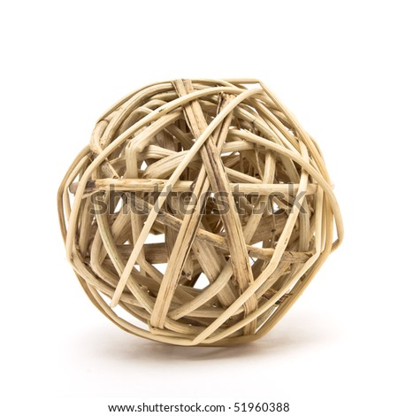 Woven wickerwork ball made from bamboo, reed or willow isolated against white background. - stock photo