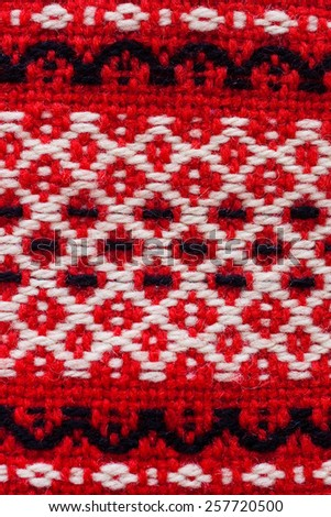 woven wool textile - red, black and white - stock photo