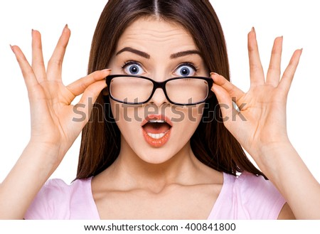 Wow, I can't believe it!! Surprised young woman isolated on a white background - stock photo