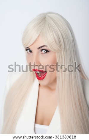 Wow. Portrait of cheerful young blond girl is expressing surprise. She is looking at camera positively. Isolated - stock photo