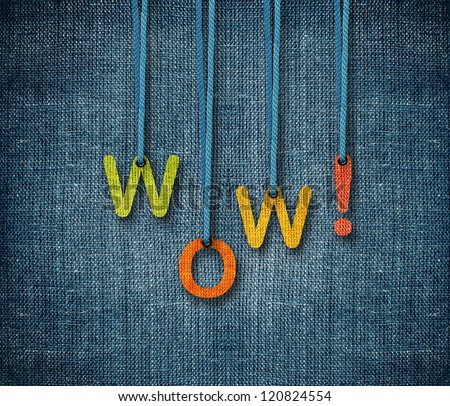 Wow word hanging by rope as puppeteer on sackcloth background. - stock photo