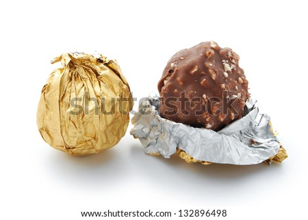 wrap and unwrap chocolate candy on white - stock photo