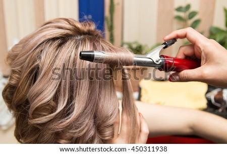 wrap hair curling in a beauty salon - stock photo