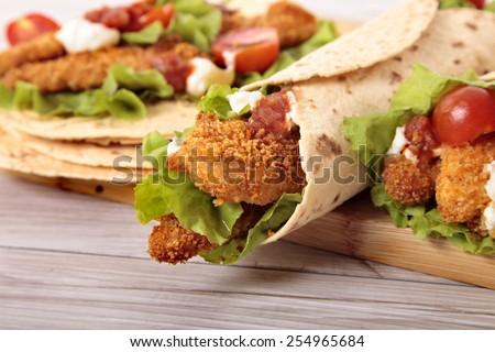 Wrap sandwich : Making deep fried chicken wrap sandwich with stack of tortillas - stock photo