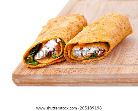 Wrap sandwich with feta cheese tomatoes and basil