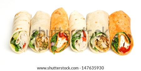 Wrap sandwiches arranged in a row. - stock photo