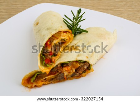Wrap tortilla with meat, vegetables and spices