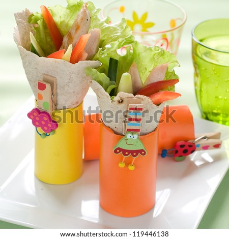 Wrap with grilled chicken and vegetables for children party, selective focus - stock photo