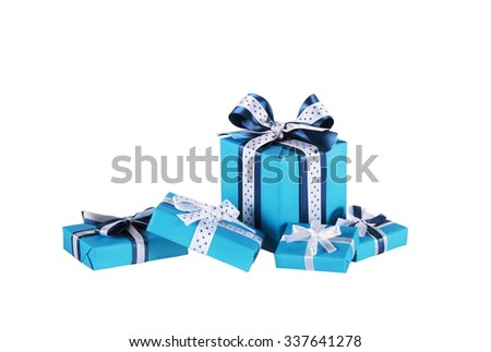 wrapped blue gift boxes with ribbon bows, isolated on white  - stock photo