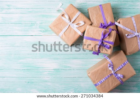 Wrapped boxes with presents on turquoise painted wooden planks. Selective focus. Place for text. - stock photo
