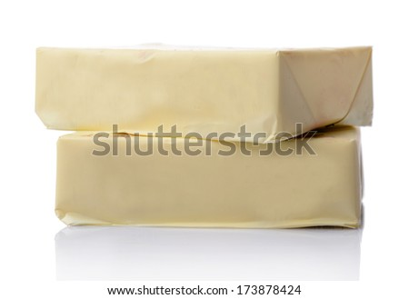 Wrapped butter sticks, isolated on white - stock photo
