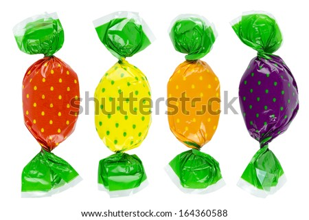 Wrapped candies or sweets on a white background.  - stock photo