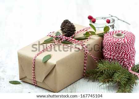 Wrapped Christmas present on Wooden Background - stock photo