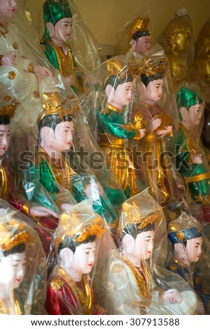 Wrapped Deities ready to be sold in  Hanoi, Vietnam - stock photo