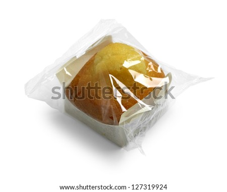 wrapped muffin on white background