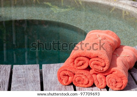 wrapped orange towels by the private pool