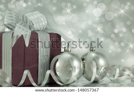 Wrapped present with silver baubles and ribbon