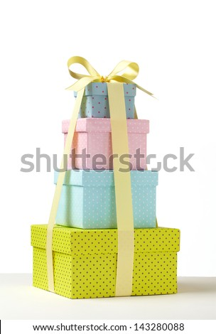 Wrapped presents stacked in the form of a pyramid.   Group of presents. Gift boxes with origami bows.  - stock photo