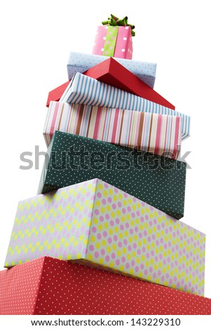 Wrapped presents stacked in the form of a pyramid with cute Gift box at the top. Group of presents. Gift boxes with origami bows. - stock photo