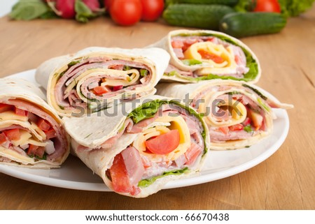 wrapped tortilla sandwiches rolls cut in half and ingredients