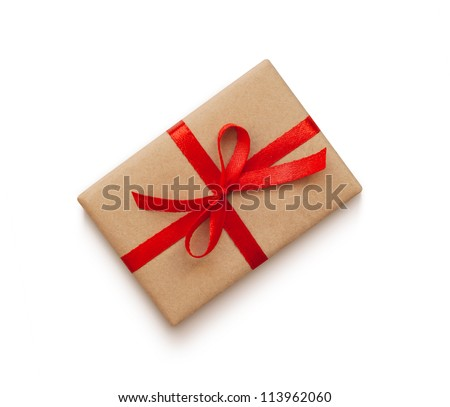 Wrapped vintage gift box with red ribbon bow, isolated on white - stock photo