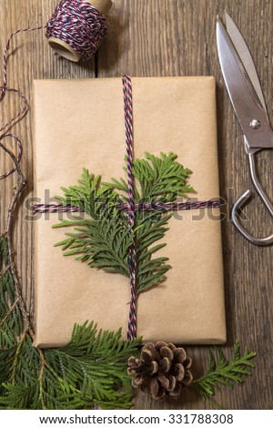Wrapping Christmas presents with the cypress branches - stock photo