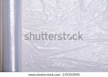Wrapping plastic stretch film background. - stock photo