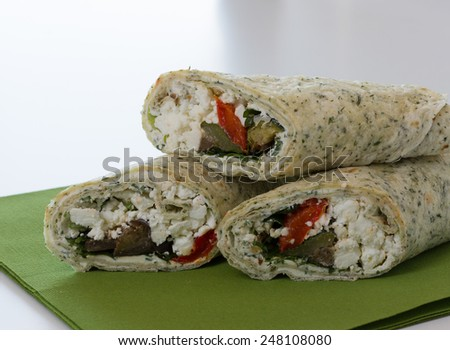 Wraps with vegetable and feta on green napkin - stock photo