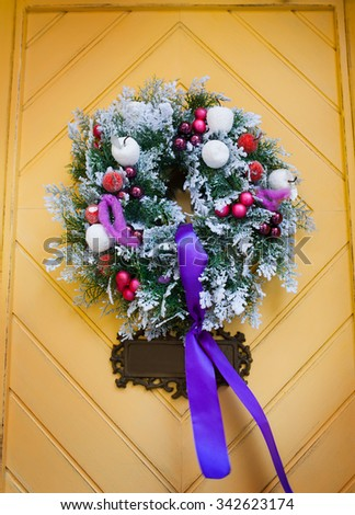 Wreath decoration at door for Christmas holiday. - stock photo
