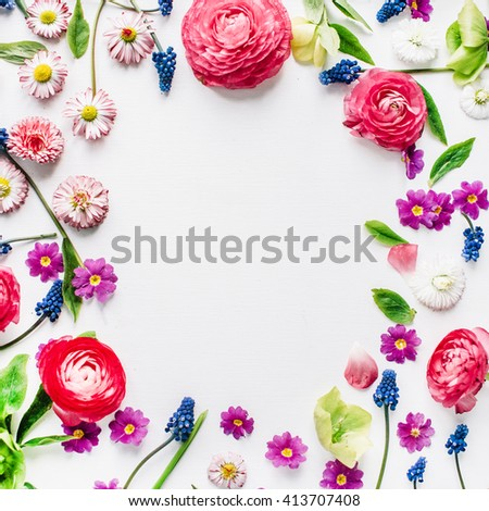 wreath frame with roses, muscari, chamomile, ranunculus, branches, leaves, petals and buds isolated on white background. flat lay, overhead view - stock photo