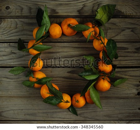 Wreath from tangerine on the wood table - stock photo