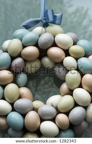 Wreath of Easter eggs on front door - stock photo
