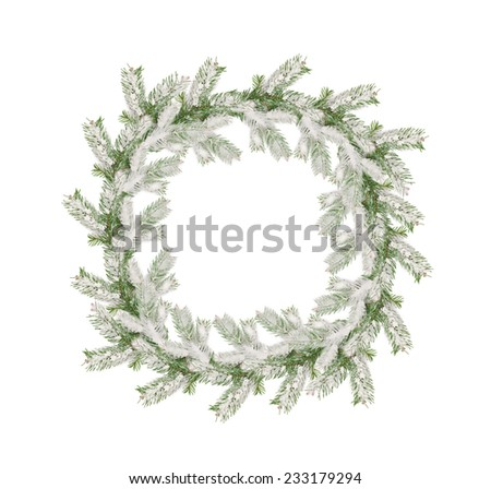 wreath of snow-covered branches of Christmas tree isolated on white background. - stock photo