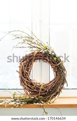 Wreath with a wicker and willow at a window