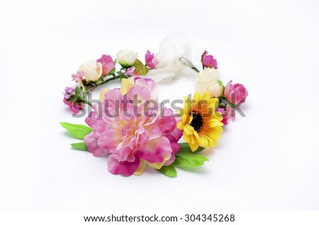 wreath with colored flowers isolated on white - stock photo