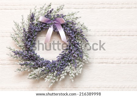 Wreath with lavender flowers on lace fabric background, selective focus - stock photo