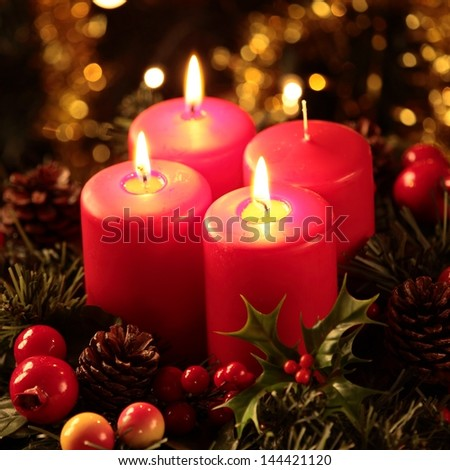 Wreath with three burning candles - stock photo