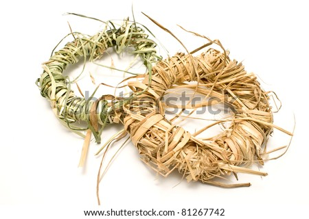 Wreaths made of straw isolated on white