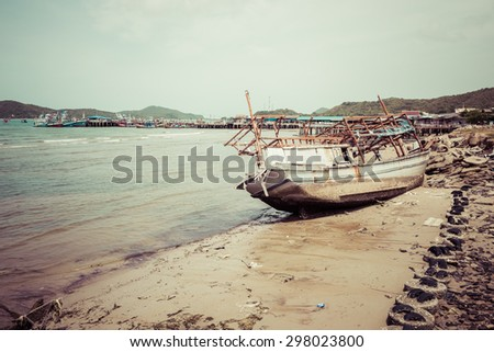 wreck fishing boat at east coast of Thailand, process color - stock photo