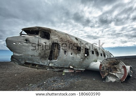 Wreck of a US military plane crashed in the middle of the nowhere. The plane ran out of fuel and crashed in a desert not far from Vik, South Iceland in 1973. The crew survived.  - stock photo