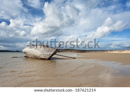Wrecked boat at Bunbeg beach, Donegal, Ireland - stock photo