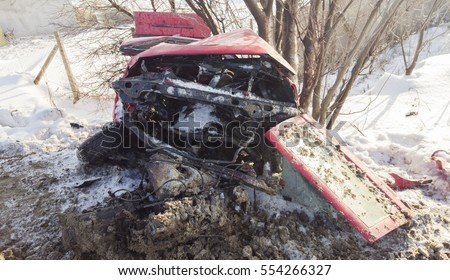 wrecked car in accident, dramatic winter scene