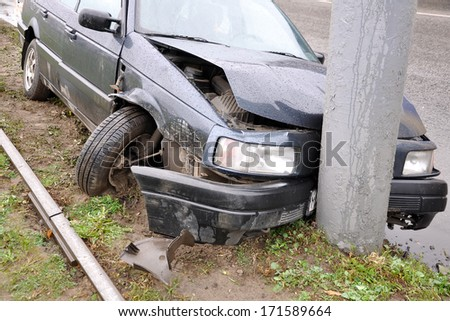 Wrecked car in the city. horizontal photo. - stock photo