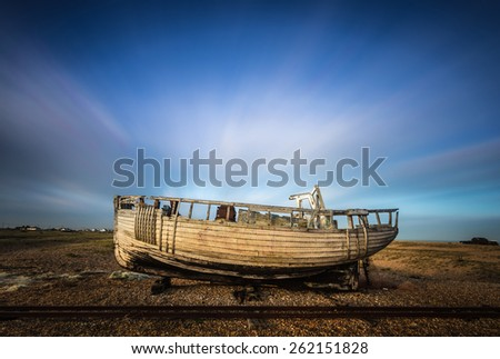 Wrecked ship with moving clouds at Dungeness beach, England, UK - stock photo